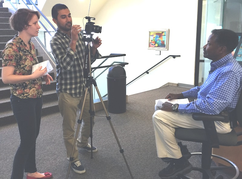 Students shoot video of Prof. Ranford Hopkins for a story on the 25th anniversary of Multicultural Day at Moorpark College.